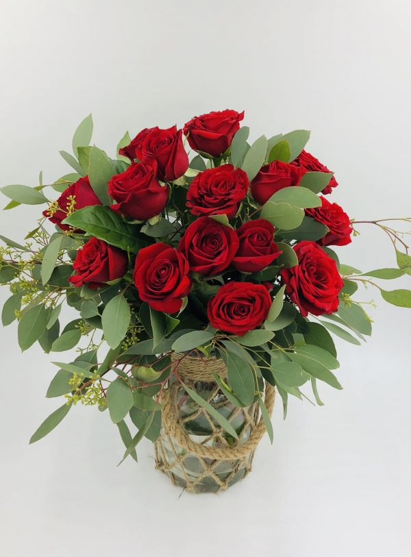 A dozen of red roses in a Jute vase 1